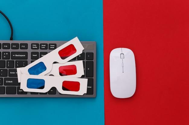 Clavier pc avec lunettes 3d sur bleu rouge. divertissement