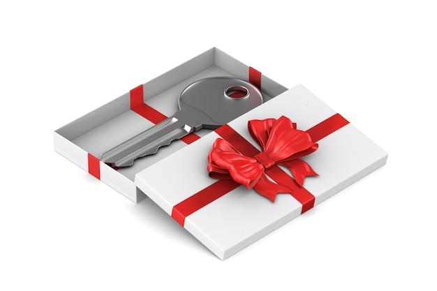 Clé dans une boîte cadeau sur un espace blanc
