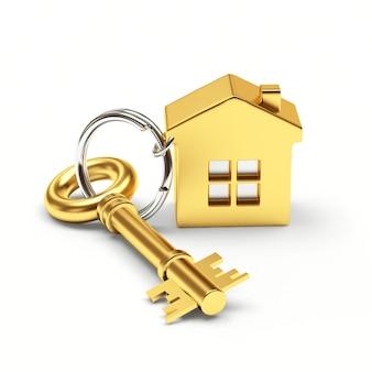 Clé dorée avec porte-clés maison