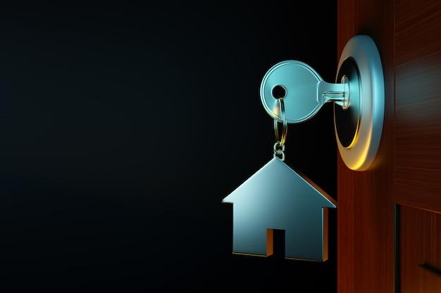 Clé de maison en argent dans la porte.