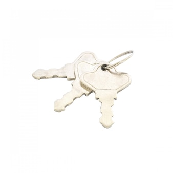 Clé de maison closeup, clé métallique isolée on white