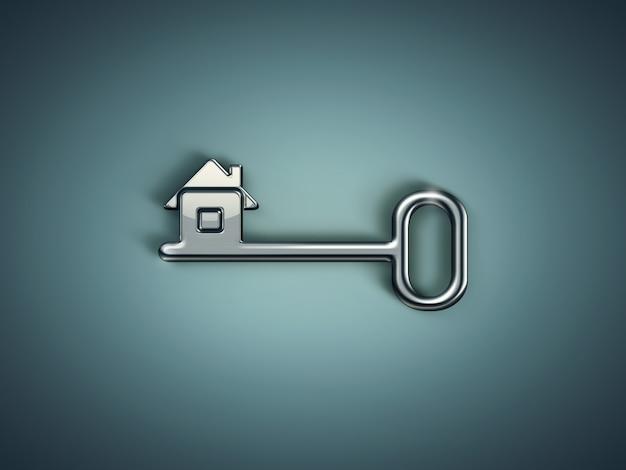 Clé en métal avec maison abstraite sur fond vert