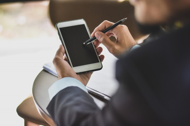 Close up businessman using mobile smart phone business communication technology