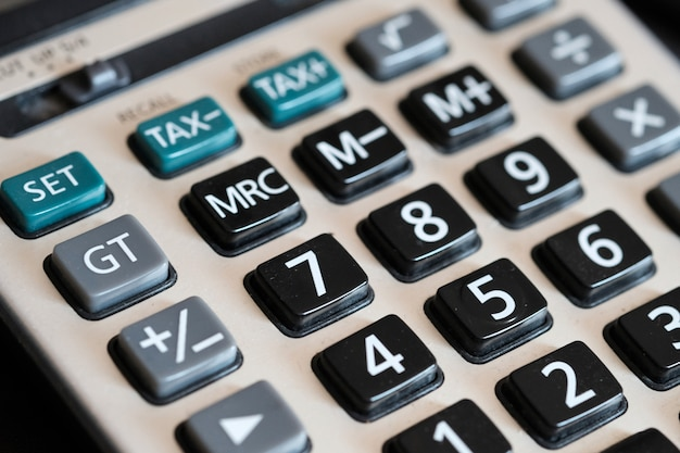 Close up button calculator, on table