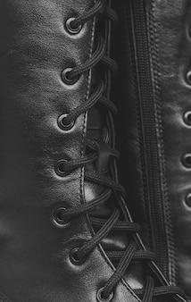 Close-up de chaussures pour femmes wellington, rivet de chaussures et photo d'arrière-plan textile