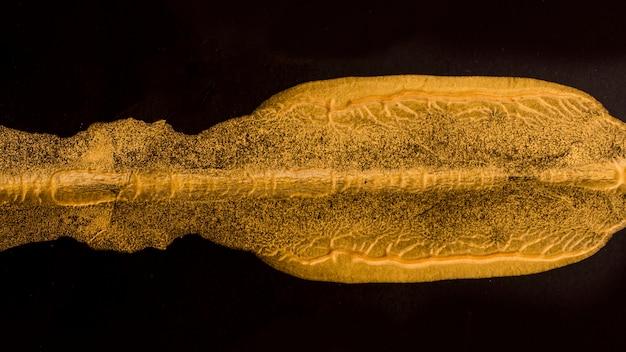 Close-up élégante peinture dorée