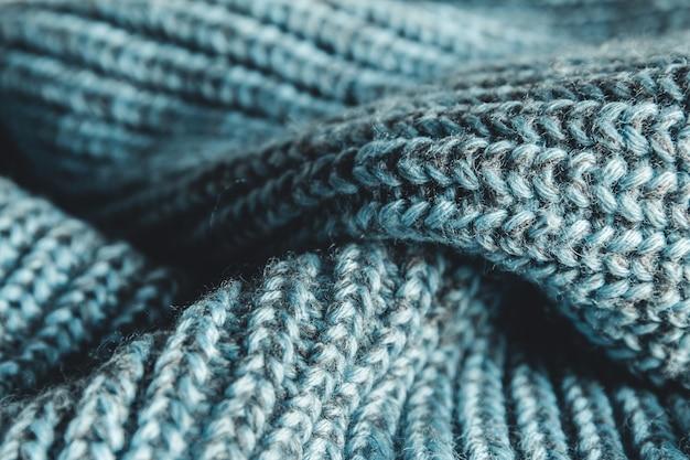 Close up fond de pull tricoté bleu