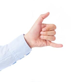 Close-up de la main faisant un appel téléphonique me geste