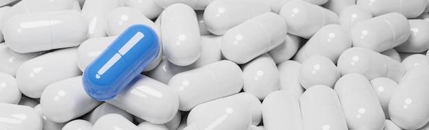 Close up of blue pill capsule dans de nombreuses capsules de pilules blanches