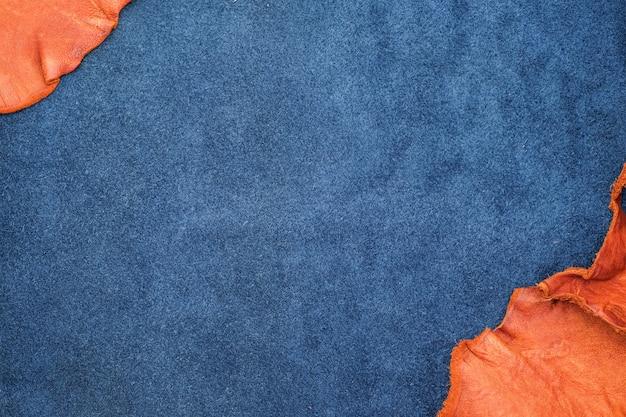 Close up orange et cuir bleu marine divisent en deux sections, texture fashion