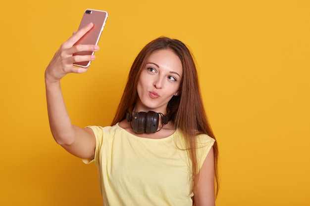 Close up portrait of beautiful amazing lady making selfie via telephone