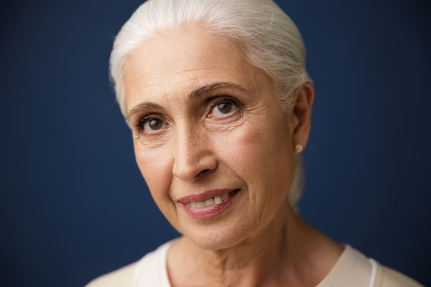 Close-up portrait of smiling mature caucasian woman