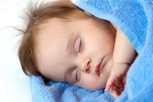 Close-up portrait of a sweet sleepping little girl