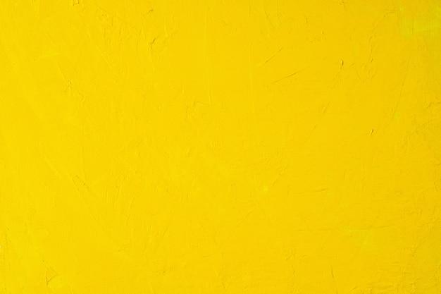 Close up texture peinture de couleur jaune sur toile pinceau marque fond de trait
