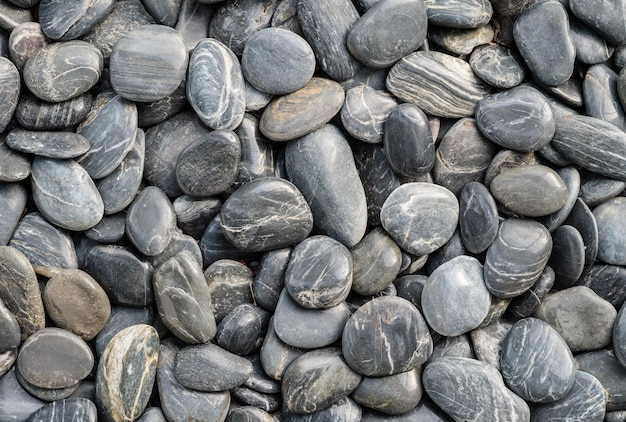 Closeup beau sol en pierre noire pour la décoration dans le fond texturé de jardin