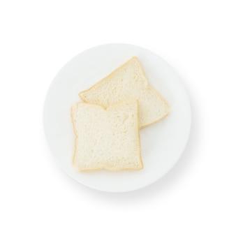 Closeup deux tranches de pain sur plat isolé sur blanc