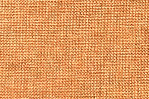 Closeup fond orange textile. structure de la macro de tissu
