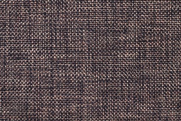 Closeup fond textile marron et noir. structure de la macro de tissu