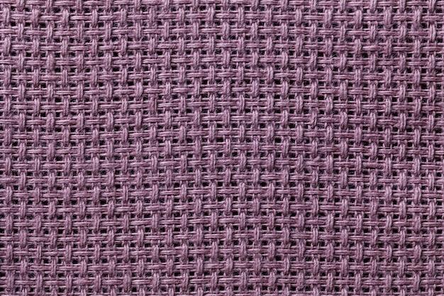 Closeup fond violet textile.