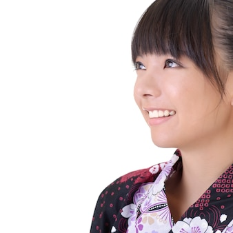 Closeup portrait de jeune fille japonaise visage souriant avec fond sur blanc.