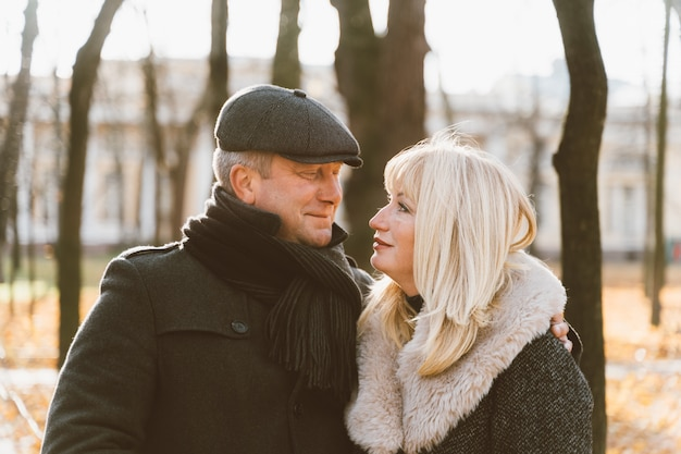 Closeup portrait of a happy blonde mature woman and a beautiful brunette brunette middle-age man