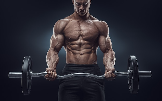 Closeup portrait of a muscular man workout