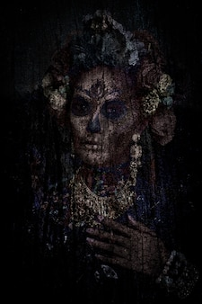 Closeup portrait of a woman with a sugar skull maquillage