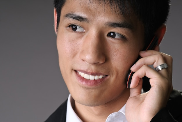 Closeup portrait of young business man use cellphone
