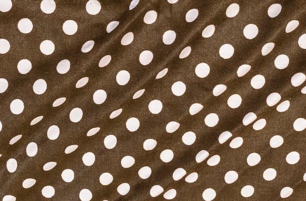 Closeup surface fond de texture de mouchoir brun foncé vieux et ridé