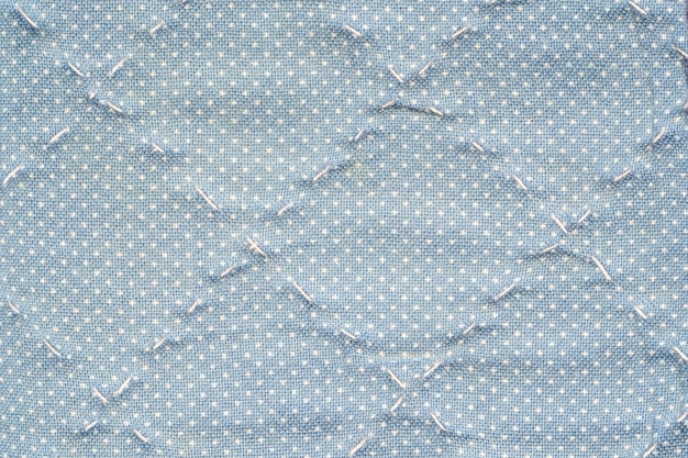 Closeup surface tissu bleu fond texturé