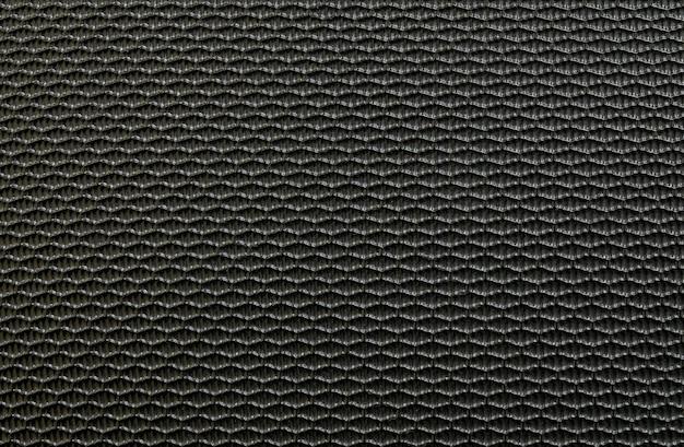 Closeup surface vieille fibre noire au fond de texture de bagages