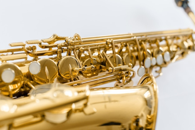 Closeup touches saxophone