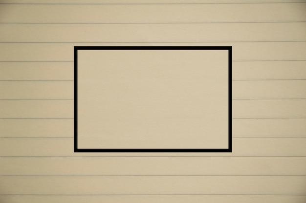 Closeup vieux cahier jaune / marron, texture du papier et carré au centre
