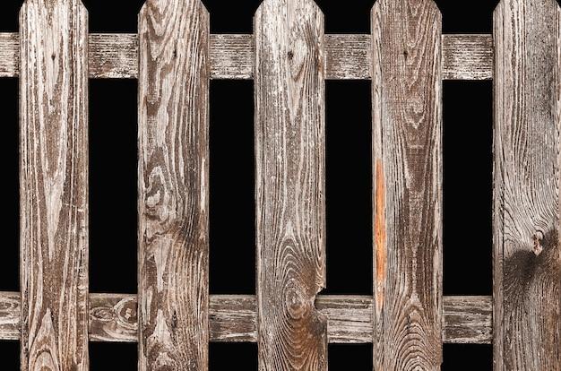 Clôture en bois sur fond noir