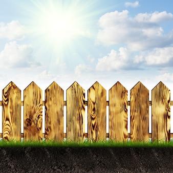 Clôture en bois de jardin sur l'herbe par une journée ensoleillée