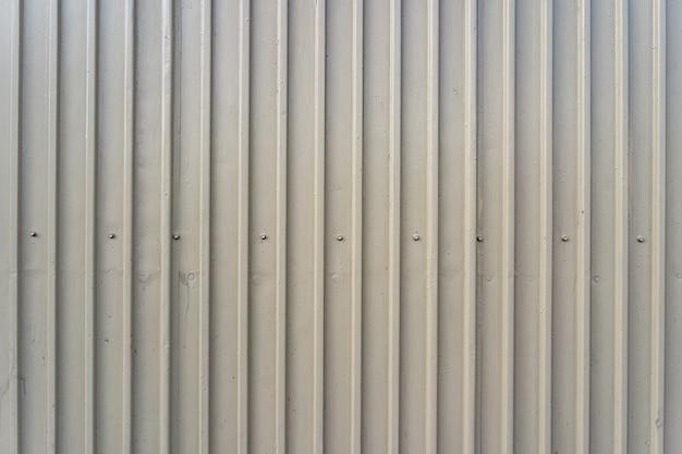 Clôture en fer blanc bordée de fond. texture métallique