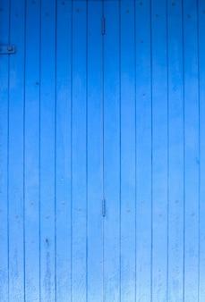 Clôture, plancher ou panneau de mur en bois brut peint de couleur bleue