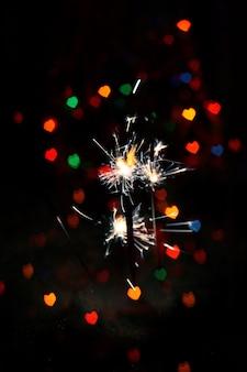 Coeur bokeh et sparkler