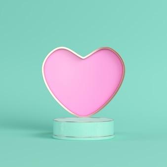 Coeur rose dans une armature en métal avec fond vert clair de postament cylindrique dans des couleurs pastel.