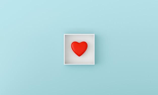 Coeur rouge dans la boîte sur fond bleu clair pastel. concept doux de la saint-valentin.