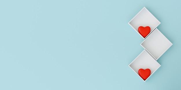 Coeur rouge dans la boîte sur le mur bleu clair pastel. concept doux de la saint-valentin.