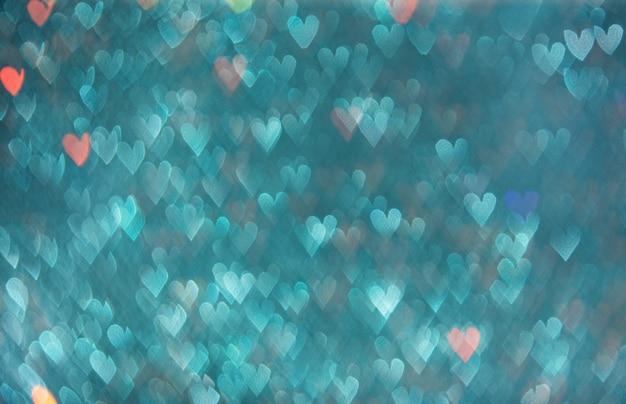Coeurs bleus bokeh.