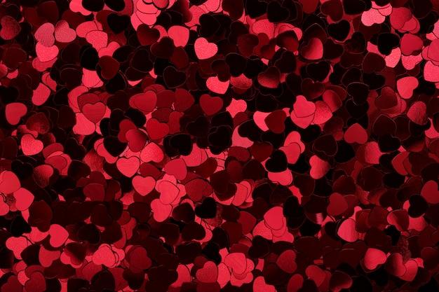 Coeurs étincelants fond de paillettes rouges