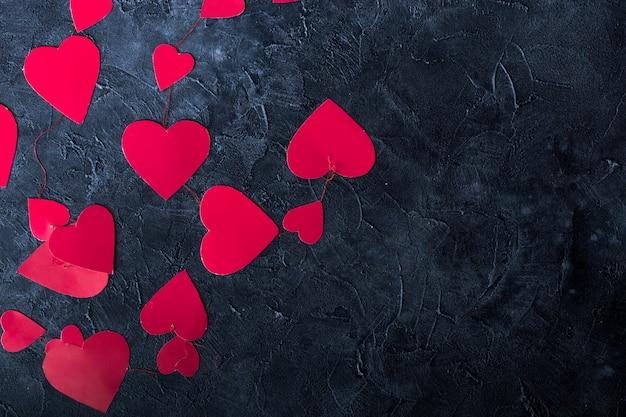 Coeurs de papier de fond de saint-valentin. élément de design pour carte de voeux romantique