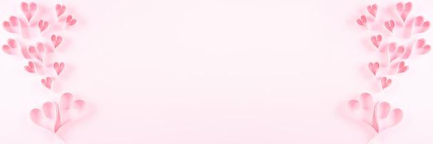 Coeurs de papier rose sur fond de papier rose, concept de l'amour et de la saint-valentin.