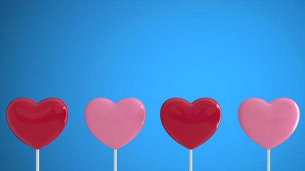 Coeurs rouges et roses sur un bâton sur un mur bleu