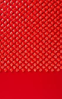 Coeurs de saint valentin motif de fond rendu 3d illustration. mise à plat de couleur rouge audacieux. carte de voeux d'amour, affiche, modèle de bannière