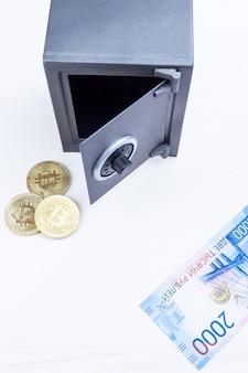 Coffre-fort avec betcoin et argent