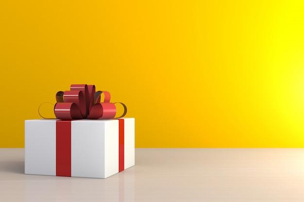 Coffret cadeau avec ruban rouge sur table en bois, coffret blanc sur fond jaune avec espace