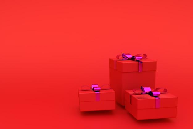 Coffrets cadeaux en papier rouge, décorés de ruban. de carte de voeux, cadre, bannière. prise de vue en studio, copie copyspace.